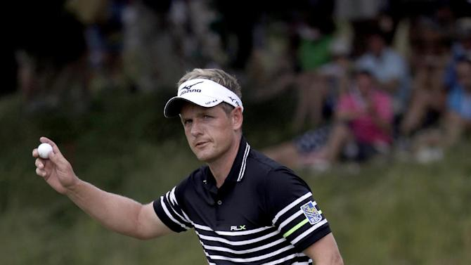 Luke Donald, of England, reacts after a putt on the fifth hole during the third round of the U.S. Open golf tournament at Merion Golf Club, Saturday, June 15, 2013, in Ardmore, Pa. (AP Photo/Gene J. Puskar)