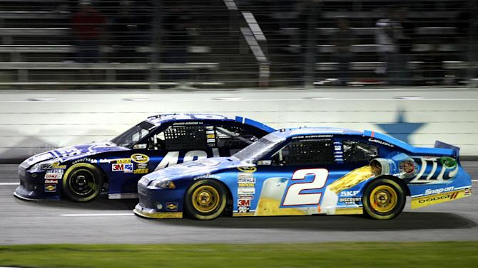 Brad Keselowski (2) and Jimmie Johnson (48) compete down the front stretch on the final laps of the NASCAR Sprint Cup Series auto race at Texas Motor Speedway, Sunday, Nov. 4, 2012, in Fort Worth, Texas. Johnson won the race. (AP Photo/Tony Gutierrez)