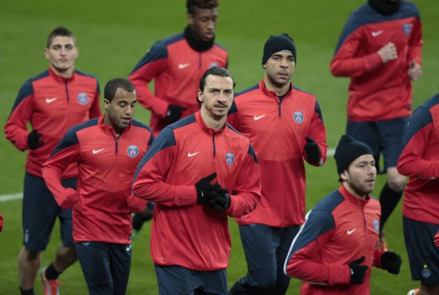 Paris St. Germain's Ibrahimovic and team mates warm up during a training session in Leverkusen