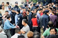 Chinese residents gather outside the city government offices in Ningbo, in eastern China's Zhejiang province on October 29. Ningbo city said Sunday that work on the 55.9-billion-yuan ($8.9 billion) oil and petrochemical complex would stop after thousands of local residents clashed with police in a week-long protest over pollution fears
