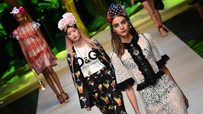 Models present creations for fashion house Dolce Gabbana on September 25, 2016 in Milan