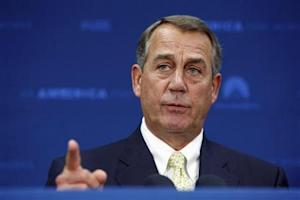 U.S. House Speaker Boehner takes a question as he addresses reporters after a Republican caucus meeting at the U.S. Capitol in Washington
