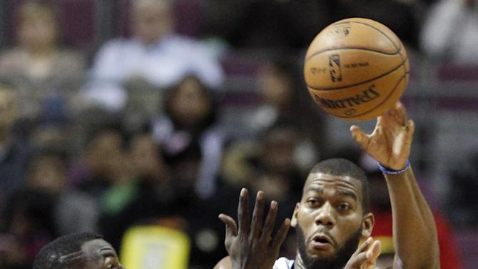 Detroit Pistons center Greg Monroe, right, is forced to pass the ball against San Antonio Spurs center DeJuan Blair, left, and guard Tony Parker (9) in the first half of an NBA basketball game Friday, Feb. 8, 2013, in Auburn Hills, Mich. (AP Photo/Duane Burleson)