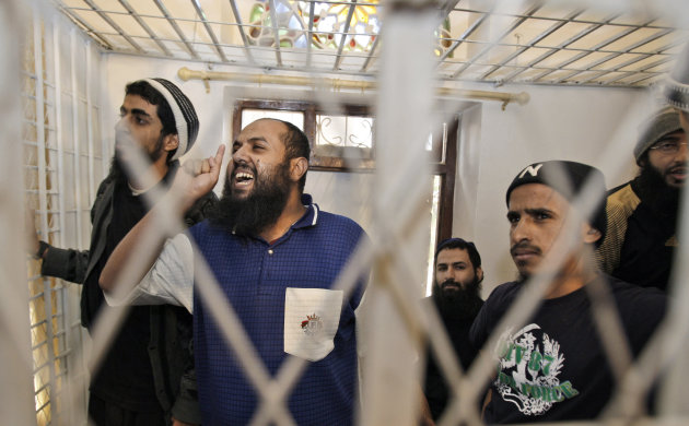 FILE - In this Sunday, Feb. 6, 2011 file photo, Badr al-Sudani, second from left, a suspected al-Qaida militant gestures to the judge during his trial along with other militants at a state security court in Sanaa, Yemen. Al-Qaida's branch in Yemen is seen by Washington as the most dangerous arm of the terror group after repeated attempts to carry out bombings on American soil. (AP Photo/Hani Mohammed, File)