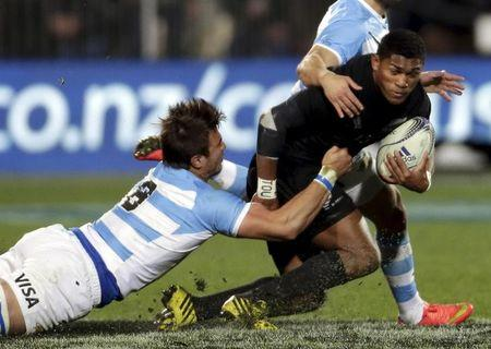 Naholo of New Zealand's All Blacks is tackled by Argentina's Isa during their Rugby Championship match at AMI Stadium in Christchurch