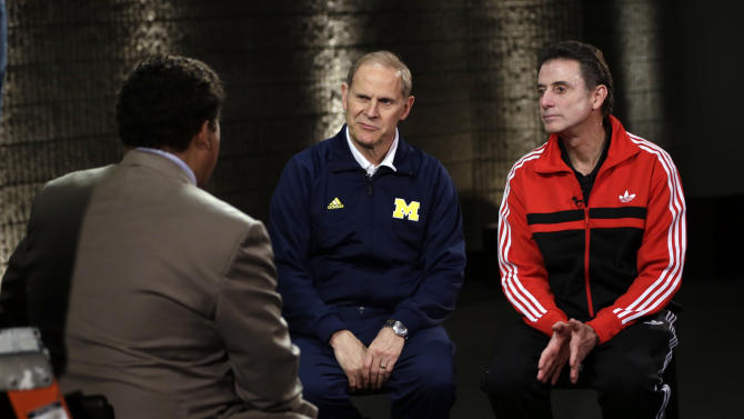 Louisville head coach Rick Pitino and Michigan head coach John Beilein, left, participate in a television interview for their NCAA Final Four tournament college basketball game Sunday, April 7, 2013, in Atlanta. Louisville plays Michigan in the championship game on Monday. (AP Photo/David J. Phillip)