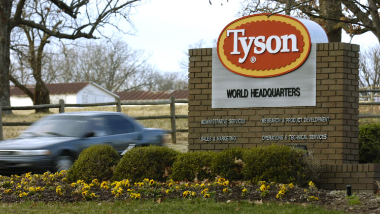FILE - In this Jan. 29, 2006, file photo, a car passes in front of a Tyson Foods Inc., sign at Tyson headquarters in Springdale, Ark.  The nation's largest meat company on Friday, Oct. 12, 2012, says it's launching an animal treatment audit of suppliers' farms. The news comes as animal welfare activists have been pressuring Tyson to move away from cramped cages for pregnant pigs. (AP Photo/April L. Brown, File)