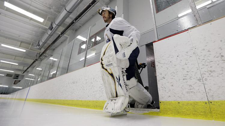 Buffalo Sabres goalie Ryan Miller skates onto the ice for an informal NHL hockey workout in Amherst, N.Y., Friday, Jan. 11, 2013. (AP Photo/David Duprey)