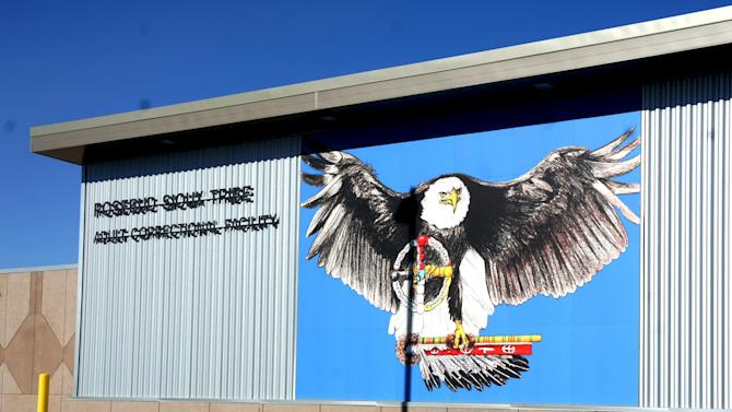 This image provided by Tani Gordon of The Sicangu Eyapaha shows the mural outside the new Rosebud Sioux Tribe Adult Correctional Facility, Wolakota Elkupi Oti, on the Rosebud Reservation near Rosebud, S.D. The opening and staffing may be in question due to budget cuts. When it comes to the automatic spending cuts that began taking effect this month, federal lawmakers spared from hard hits those programs that help the nation's most vulnerable, such as food stamps, Social Security and veterans' assistance. That wasn't the case with programs for American Indian reservations, where unemployment is far above the national average, women suffer disproportionately from sexual assaults, and school districts largely lack a tax base to make up for the cuts. (AP Photo//The Sicangu Eyapaha, Tani Gordon)
