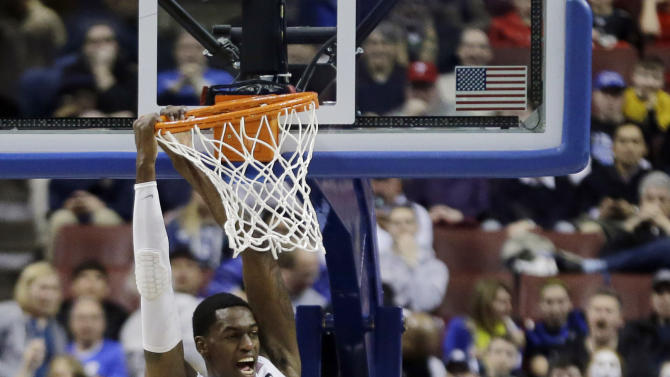 San Diego State's Deshawn Stephens (23) reacts after a dunk past JJ O'Brien (20) and Florida Gulf Coast's Filip Cvjeticanin (15) during the first half of a third-round game of the NCAA college basketball tournament, Sunday, March 24, 2013, in Philadelphia. (AP Photo/Matt Slocum)