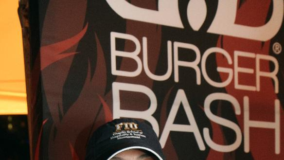 Luciana Page, a student at Florida International University, is enjoying the taste of victory after taking home top honors in Red Robin's Savory Scholar Contest with her Korean Kalbi BBQ Burger.  The unique blend of spicy and tangy authentic Korean flavors including pickled cucumbers and onions, cabbage and a Korean BBQ glazed beef patty on Brioche bun was sampled at the Food Network South Beach Wine and Food Festival during the Amstel Light Burger Bash on Feb. 22, 2013 and could potentially make a debut on the Red Robin menu as part of the Red's Tavern Double Style burger platform in 2013. (Marianela Sanchez/Invision for Red Robin/AP)