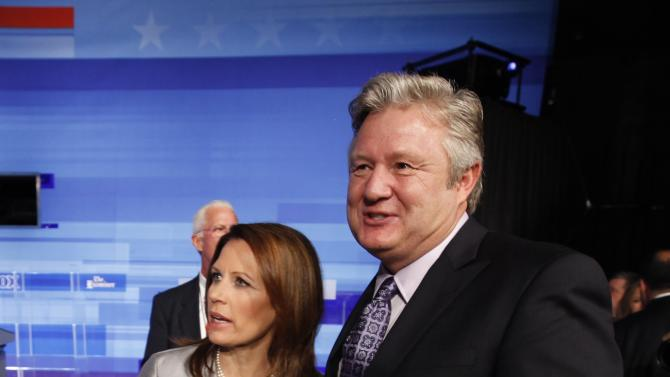 Republican presidential candidate Rep. Michele Bachmann, R-Minn. stands with her husband Marcus at the end of the Iowa GOP/Fox News Debate at the CY Stephens Auditorium in Ames, Iowa, Thursday, Aug. 11, 2011. (AP Photo/Charlie Neibergall)