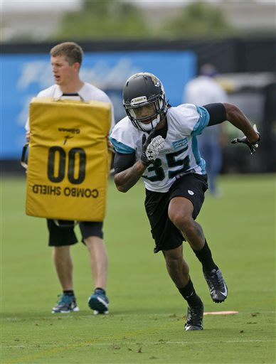 Jacksonville Jaguars cornerback Demetrius McCray (35) runs trough a drill during NFL football organized training activities, Tuesday, May 21, 2013, in Jacksonville, Fla