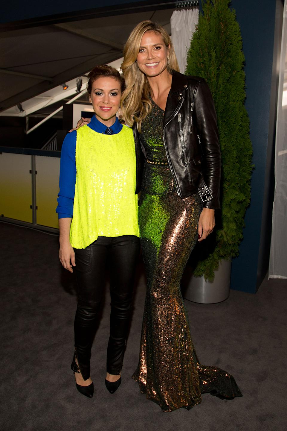 "Actress Alyssa Milano, left, and model/host Heidi Klum attend the ""Project Runway"" fashion show on Friday, Sept. 6, 2012, during Fashion Week in New York. (Photo by Dario Cantatore/Invision/AP)"