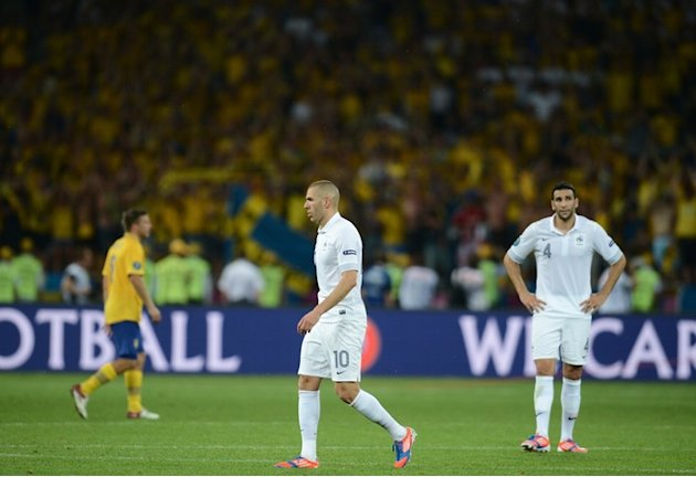 French Forward Karim Benzema (C) And French Defender Adil Rami React At The End Of The Euro 2012 Football  AFP/Getty Images