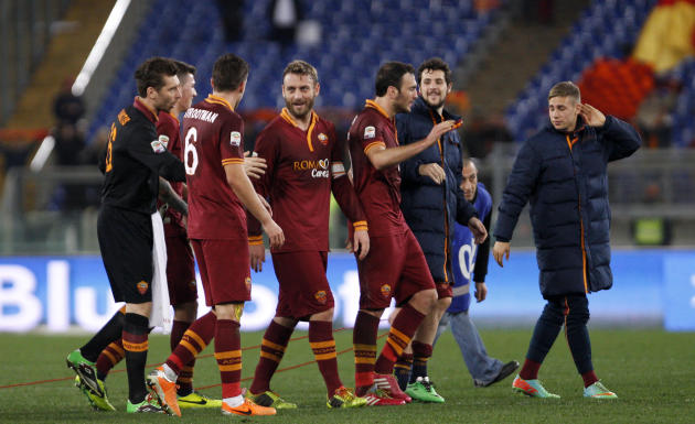 AS Roma players, including Kevin Strootman, third from left, and Daniele De Rossi, center, celebrate at the end of a Serie A soccer match between AS Roma and Sampdoria, at Rome's Olympic stadium,