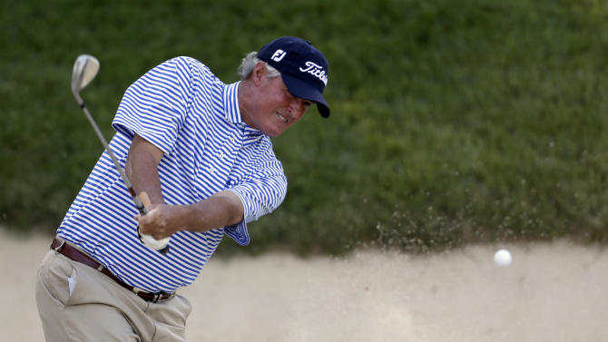 Russ Cochran hits out of a bunker on the ninth hole during the second round of the 74th Senior PGA Championship golf tournament at Bellerive Country Club Friday, May 24, 2013, in St. Louis. (AP Photo/Jeff Roberson)