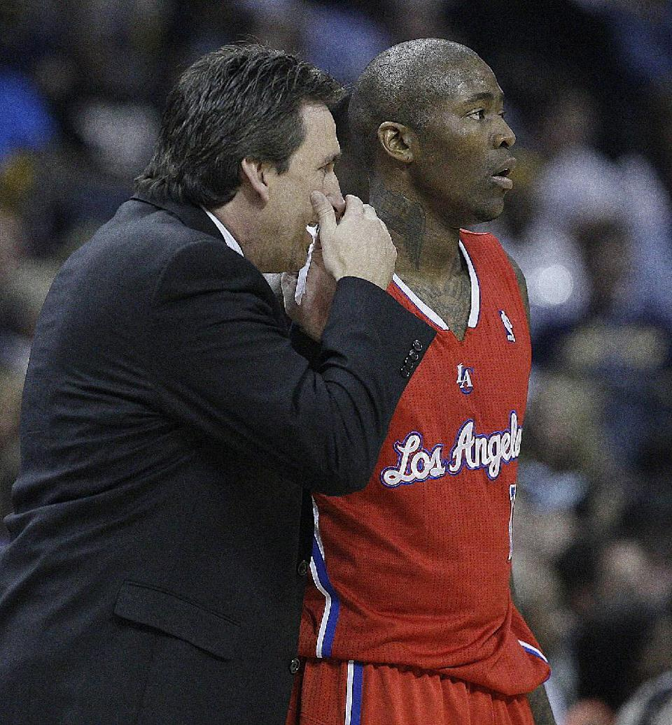 Los Angeles Clippers head coach Vinny Del Negro speaks to Los Angeles Clippers' Jamal Crawford during the first half of Game 3 in a first-round NBA basketball playoff series against the Los Angeles Clippers, in Memphis, Tenn., Thursday, April 25, 2013. (AP Photo/Danny Johnston)