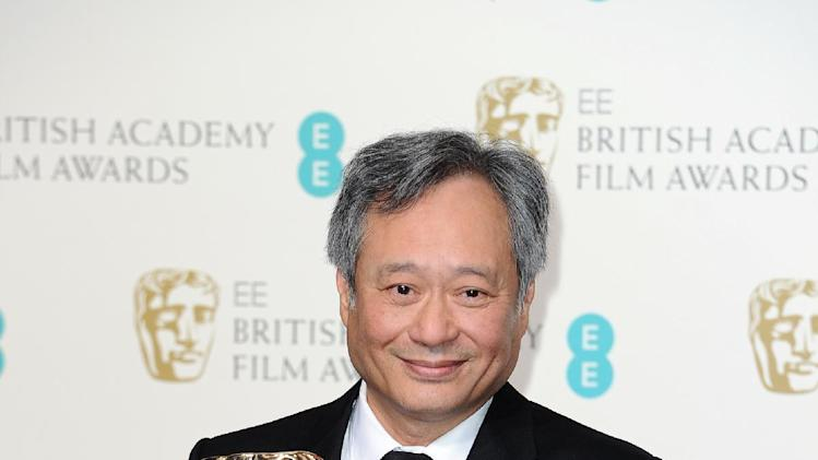 Director Ang Lee poses with the award for Cinematography in 2013 collected on behalf of Claudio Miranda backstage at the BAFTA Film Awards at the Royal Opera House on Sunday, Feb. 10, 2013, in London. (Photo by Jonathan Short/Invision/AP)