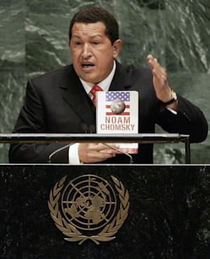 """FILE -In this Sept. 20, 2006, file photo, Venezuelan President Hugo Chavez holds a Spanish-language version of """"Hegemony or Survival: America's Quest for Global Dominance"""" by Noam Chomsky while addressing the 61st session of the United Nations General Assembly at U.N. headquarters.  During his address, Chavez, who often tried to cast himself as a champion of the American poor, called President George W. Bush """"the devil."""" (AP Photo/Julie Jacobson, File)"""