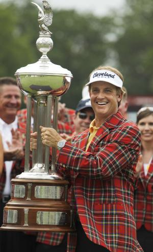 David Toms wears the winner's jacket and holds up the Colonial trophy after winning the golf tournament in Fort Worth, Texas, Sunday, May 22, 2011.  (AP Photo/LM Otero)