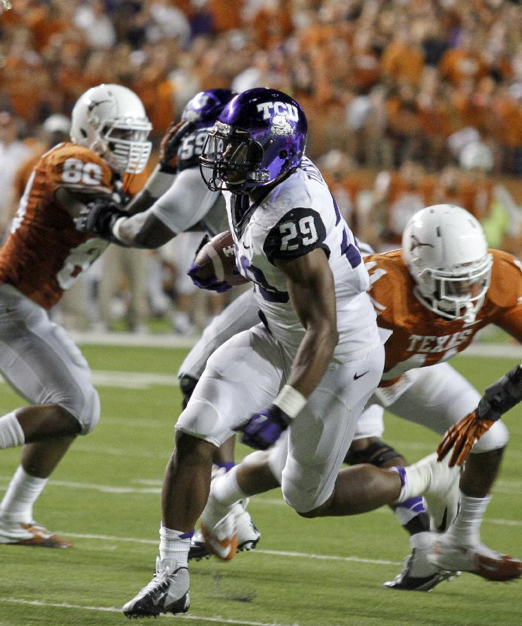 TCU's Matthew Tucker runs on third down against Texas during the first half of an NCAA college football game on Thursday, Nov. 22, 2012, in Austin, Texas. (AP Photo/Jack Plunkett)