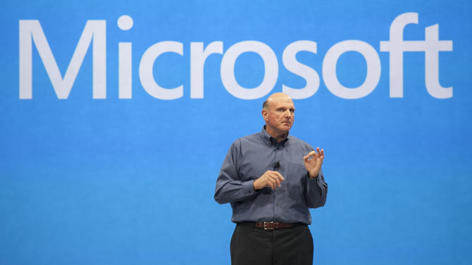 """FILE- In this Monday, June 18, 2012, file photo, Microsoft CEO Steve Ballmer unveils its""""Surface"""", a new tablet computer to compete with Apple's iPad at Hollywood's Milk Studios in Los Angeles. Microsoft announced Monday, June 25, 2012, that is paying $1.2 billion to buy Yammer, an Internet startup that has built a social network similar to Facebook for the business world. (AP Photo/Damian Dovarganes, File)"""