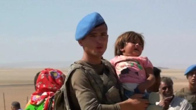 About 60,000 Syrian Kurds flee to Turkey as Islamic State advances