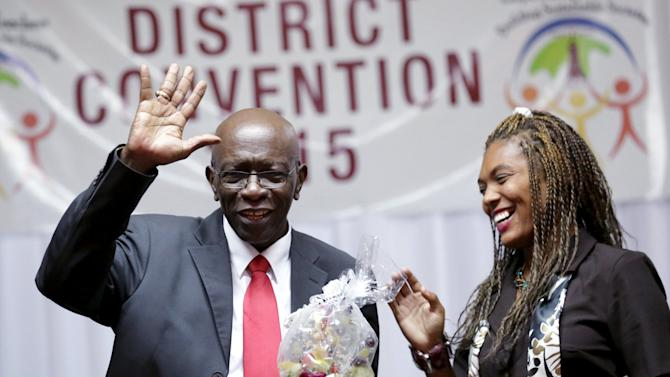 Former FIFA vice-president Warner acknowledges the audience after he was presented with a gift at the Teachers District Convention 2015 at a local hotel in Port-of-Spain
