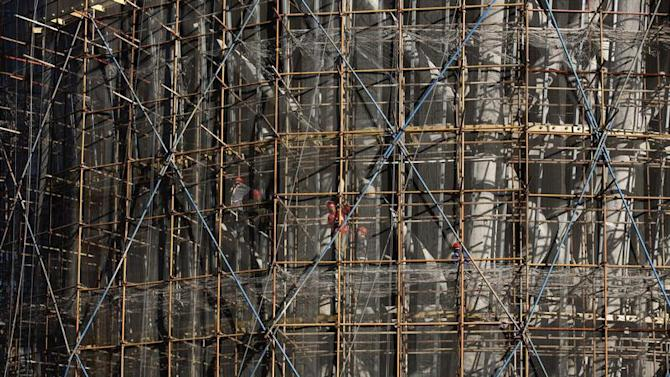 Workers labour at a construction site in Beijing