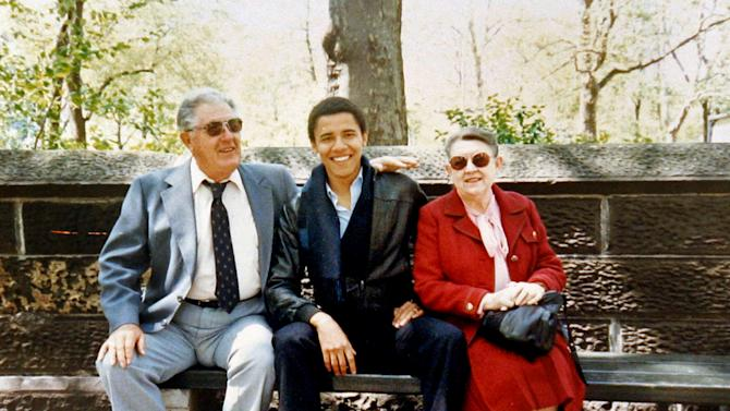 FILE - This undated photo released by Obama for America shows Barack Obama with his grandparents, Stanley Armour Dunham and Madelyn Lee Payne Dunham in New York City, during a visit with Obama, who was a student at Columbia University. How unthinkable it was, not so long ago, that a presidential election would pit a candidate fathered by an African against another condemned as un-Christian. And yet, here it is: Barack Obama vs. Mitt Romney, an African-American and a white Mormon, representatives of two groups and that have endured oppression to carve out a place in the United States. How much progress has America made against bigotry? (AP Photo/Obama for America)