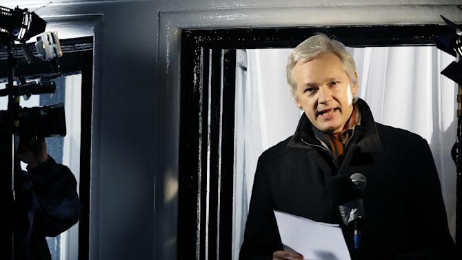 FILE - This is a Thursday, Dec. 20, 2012. file photo of Julian Assange, founder of WikiLeaks as he speaks to the media and members of the public from a balcony at the Ecuadorian Embassy in London. Assange has asked Swedish police to investigate what happened to a suitcase he suspects was stolen from him when he traveled from Sweden to Germany in 2010. Assange's lawyer, Per Samuelson, says he filed a criminal complaint with an affidavit by Assange to police at Stockholm's Arlanda Airport on Tuesday Sept. 3, 2013. (AP Photo/Kirsty Wigglesworth, File)