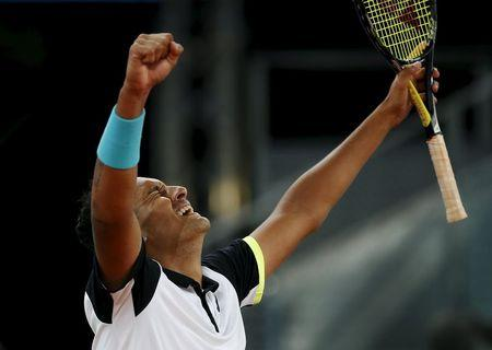 Kyrgios of Australia celebrates his victory over Federer of Switzerland at the end of their match at the Madrid Open tennis tournament in Madrid