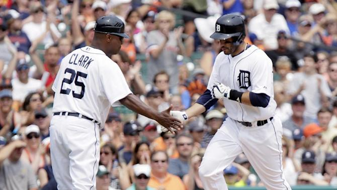 Detroit Tigers' J.D. Martinez, right, is congratulated by third base coach Dave Clark (25) after hitting a solo home run during the sixth inning of a baseball game against the Toronto Blue Jays, Sunday, July 5, 2015, in Detroit. (AP Photo/Duane Burleson)