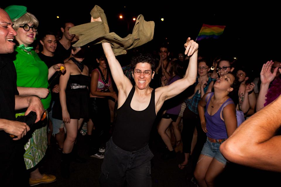 Revelers celebrate the passage of a bill legalizing same-sex marriage in New York State outside the Stonewall Inn on Christopher St, Friday, June 24, 2011, in New York. The measure passed, 33-29, following weeks of tense delays and debate. (AP Photo/John Minchillo)