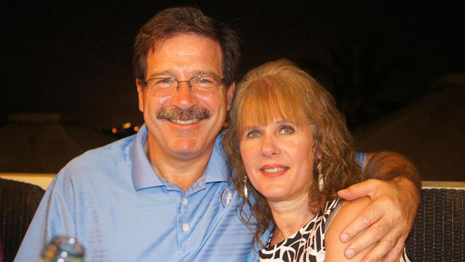 In this undated photo provided by Mark Sherlach, Mark Sherlach and his wife, school psychologist Mary Sherlach, pose for a photo. Mary Sherlach was killed Friday, Dec. 14, 2012, when a gunman opened fire at Sandy Hook Elementary School, in Newtown, Conn., killing 26 children and adults at the school. (AP Photo/Courtesy of Mark Sherlach)