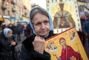 A Russia's nationalist supporter holds an icon …