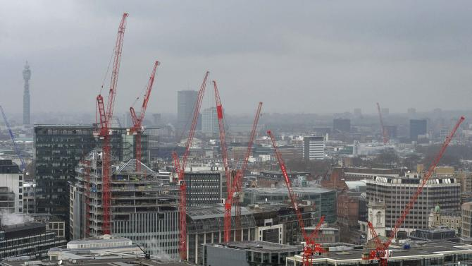 Cranes tower above construction sites in the financial district of the City of London, in Britain