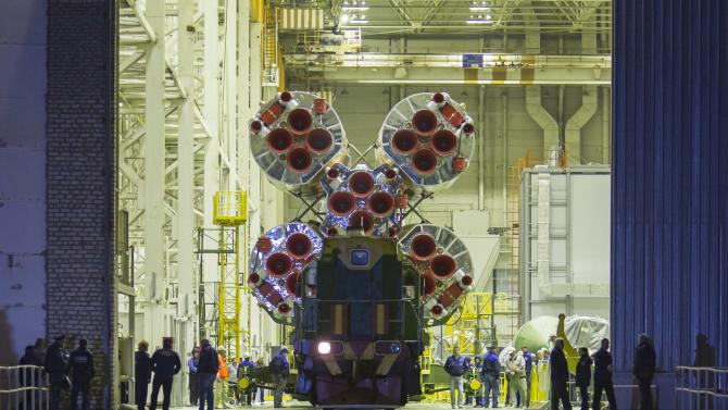 The Soyuz TMA-14M spacecraft is transported from an assembling hangar to its launch pad at Baikonur cosmodrome