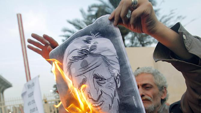 Egyptian activists burn a poster depicting U.S. Secretary of State John Kerry during a protest outside the Egyptian foreign ministry in Cairo, Egypt, Saturday, March 2, 2013. Cairo is the sixth leg of Kerry's first official overseas trip and begins the Middle East portion of his nine-day journey. (AP Photo/Amr Nabil)