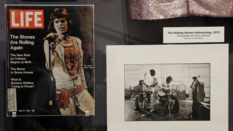 "In this May 21, 2013 photo, a 1972 Life magazine cover of Mick Jagger and photo of the band rehearsing are displayed at the Rock and Roll Hall of Fame in Cleveland. The new exhibit ""Rolling Stones 50 Years of Satisfaction"" opens Friday. (AP Photo/Mark Duncan)"