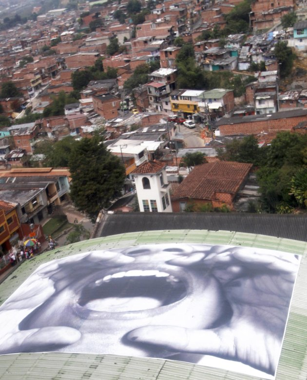 A picture is seen on the roof of a house in the neighbourhood of northeast Medellín
