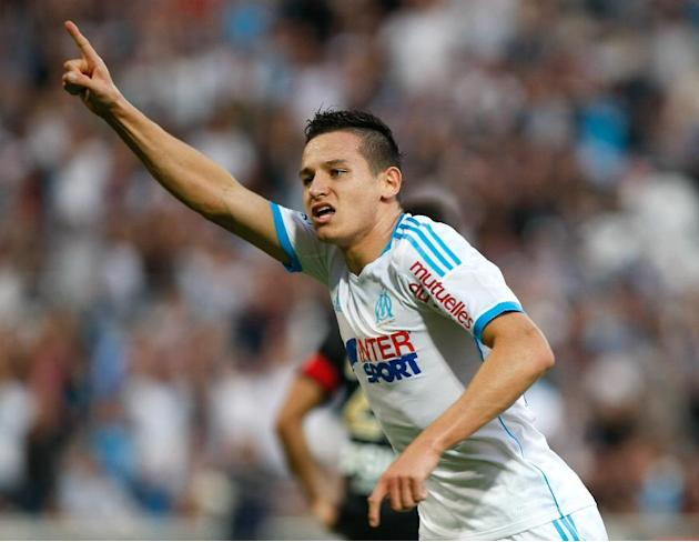 Marseille's midfielder Florian Thauvin celebrates scoring against Reims during their League One soccer match at the Velodrome Stadium in Marseille, southern France, Saturday Oct. 26, 2013