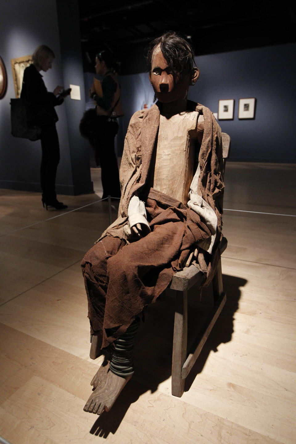 An Indonesian Tau-Tau memorial sculpture is seen on display at an exhibition 'Death: The Richard Harris Collection' at the Wellcome Collection gallery in London, Wednesday, Nov. 14, 2012. (AP Photo/Sang Tan)
