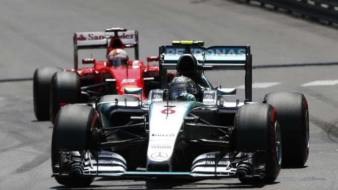 Mercedes driver Nico Rosberg of Germany leads Ferrari driver Kimi Raikkonen of Finland during the Formula One Grand Prix, at the Monaco racetrack, in Monaco, Sunday, May 24, 2015. (AP Photo/Luca Bruno)