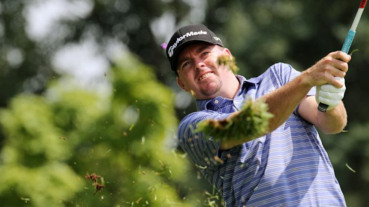 Robert Garrigus, of the United States, hits off the first fairway during the third round of the Canadian Open golf tournament, Saturday, July 28, 2012, in Ancaster, Ontario. (AP Photo/The Canadian Press, Dave Chidley)