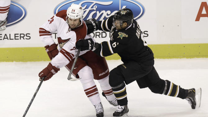 Phoenix Coyotes center Kyle Chipchura (24) controls the puck against Dallas Stars defenseman Trevor Daley (6) during the first period of an NHL hockey game Saturday, Jan. 19, 2013, in Dallas. (AP Photo/LM Otero)