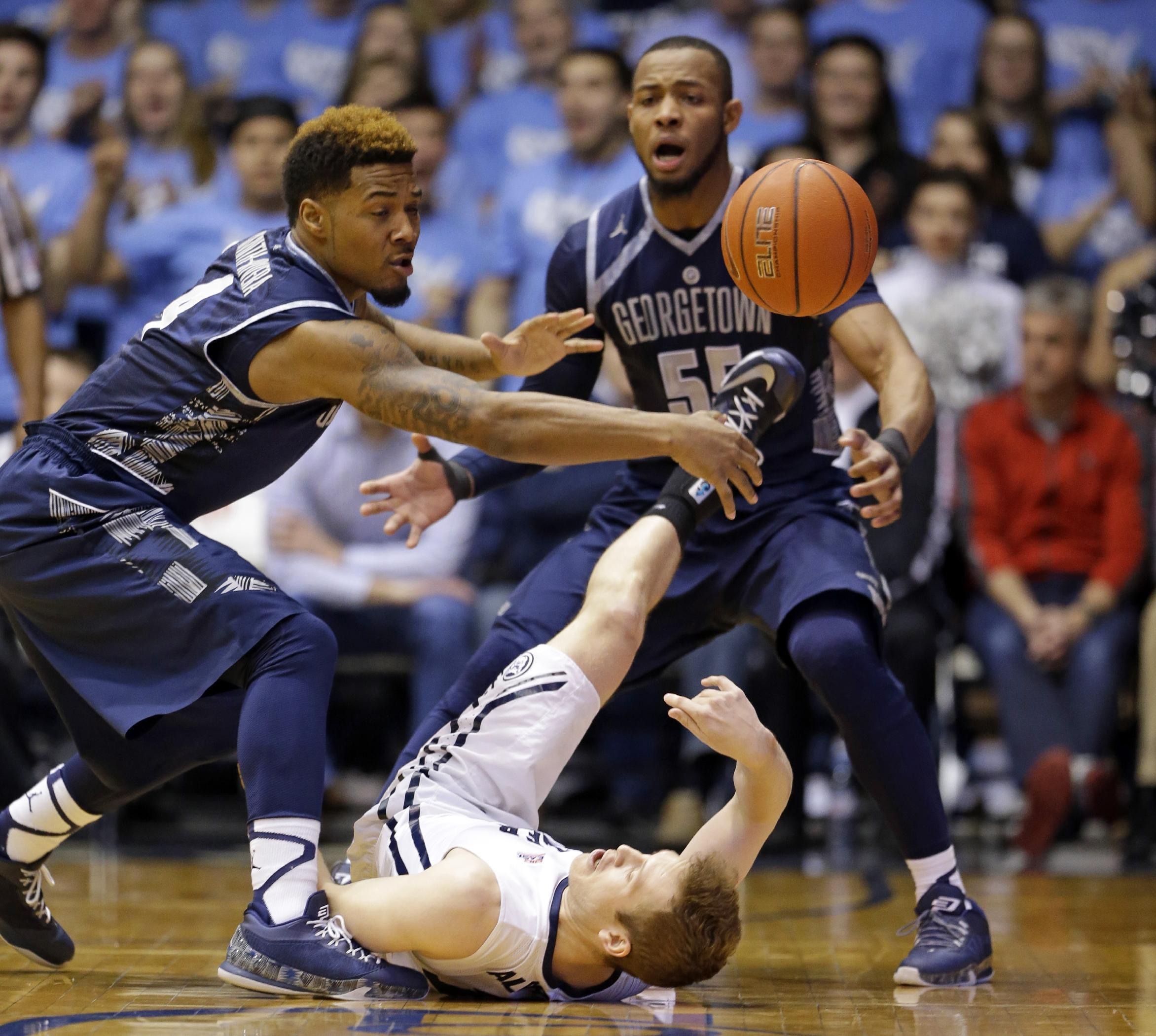 Georgetown holds off comeback to upset No. 21 Butler 60-54