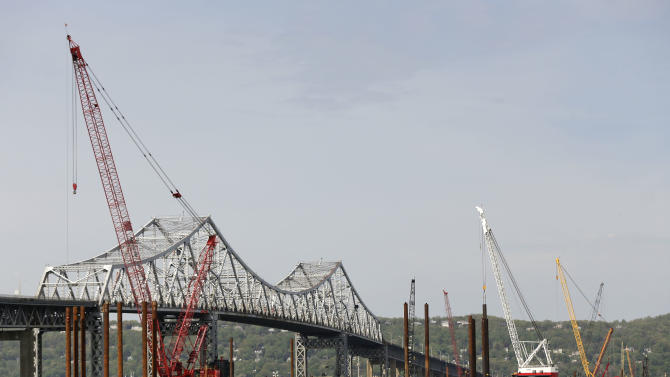 Construction crews use barges and cranes as work continues on a replacement for the 58-year-old Tappan Zee Bridge spanning the Hudson River, Tuesday, May 13, 2014, near Tarrytown, N.Y. On Wednesday, President Barack Obama plans to speak by the bridge just north of New York City to press his case that a key federal government fund used to pay for the nation's roads, bridges and ports is running dry and that the economy would be damaged if it is not replenished. (AP Photo/Julie Jacobson)