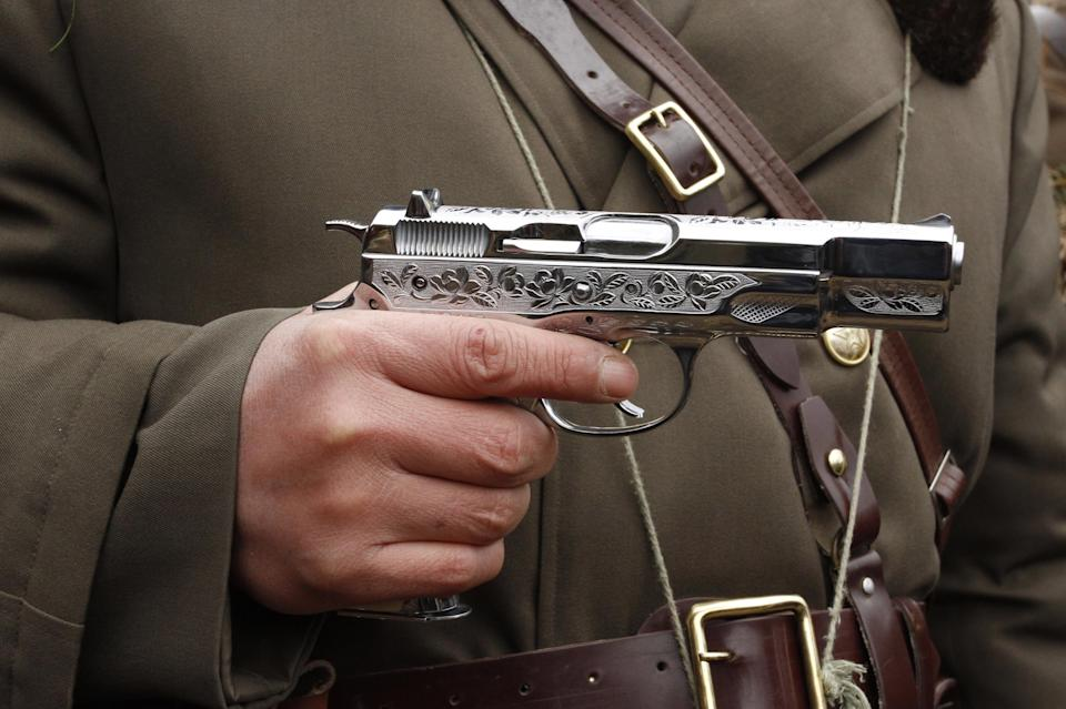 In this Sunday, March 4, 2012 photo, a North Korean soldier holds a weapon that military personnel say was given to them by North Korean leader Kim Jong Un, gather at a military base on North Korea's southwest coast, opposite South Korea's Baengnyeong Island. (AP Photo/Kim Kwang Hyon)